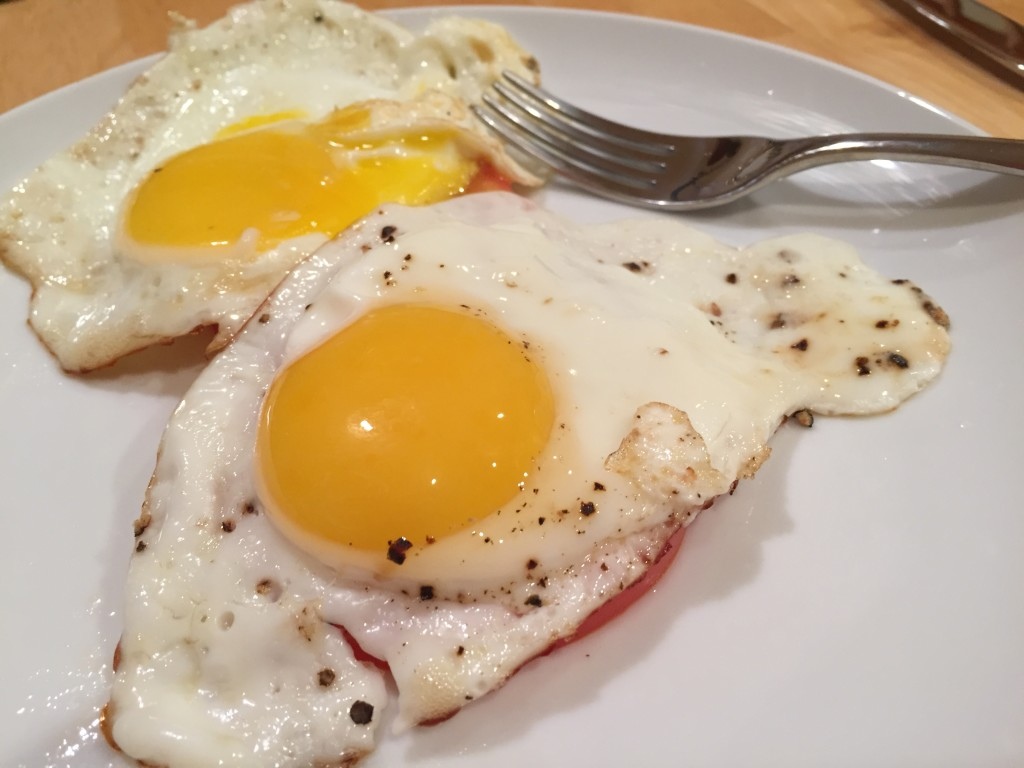 Eggs over tomatoes