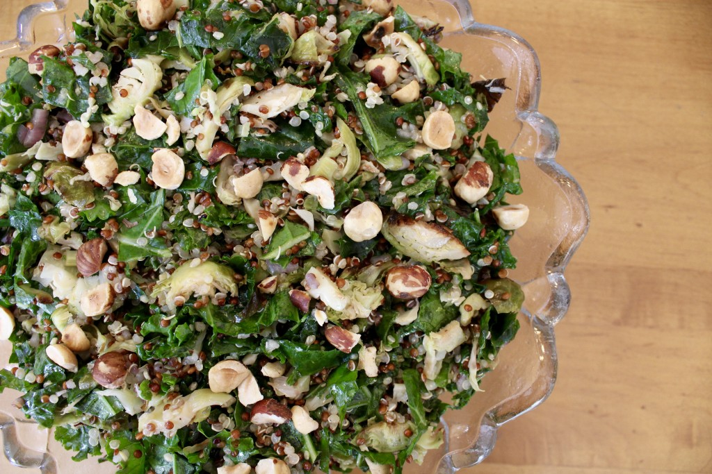 Shredded Brussels sprouts, kale, and quinoa salad with toasted hazelnuts